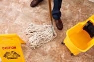 Custodial worker mopping floor