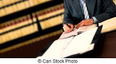 lawyer signing papers in law library
