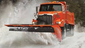 Iowa snowplow truck pushing snow
