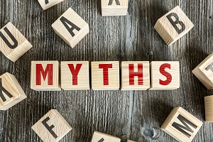 Wooden blocks spell out the word MYTHS