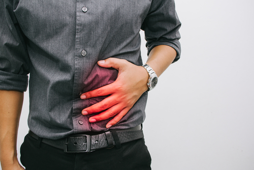 Male worker with abdominal pain from hernia
