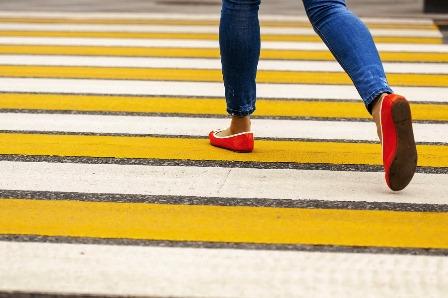 woman pedestrian crossing road