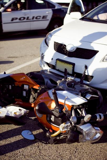 motorcycle hit by car