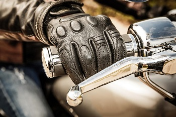 gloved hand on motorcycle