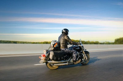Indiana motorcycle rider with Uninsured Motorists coverage