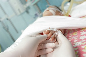 Child laying in hospital bed