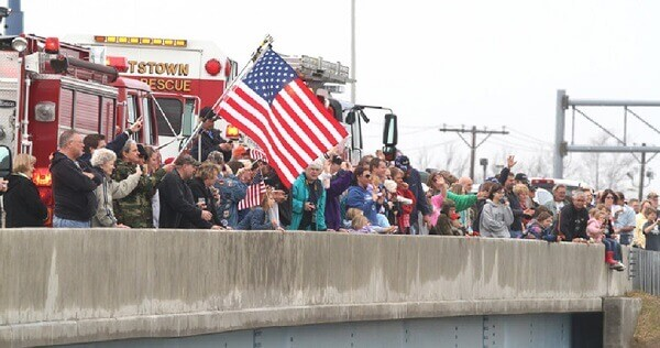 Crowd standing in front of fire truck
