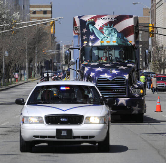 Police car and semi with WTC beams