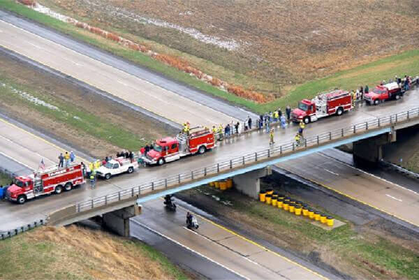 Crowd standing on bridge