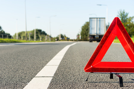 Hazard sign alerting of a wrecked semi truck ahead