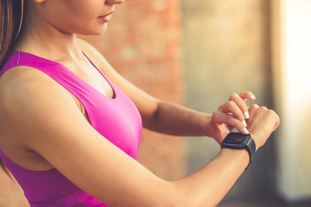 woman working out with fitness tracker fitbit