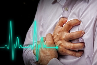 Man clutching chest having heart attack