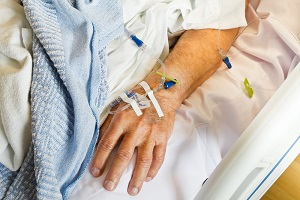 Hospital patient receives IV antibiotics for a surgical infection