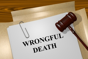 File folder with wrongful death printed on it and gavel