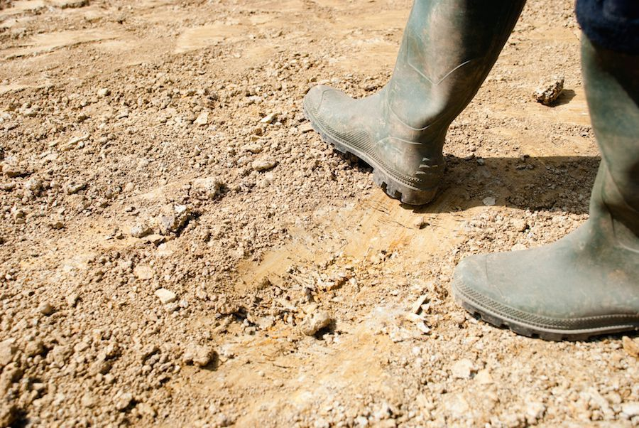 Rubber boots on a dirt trail