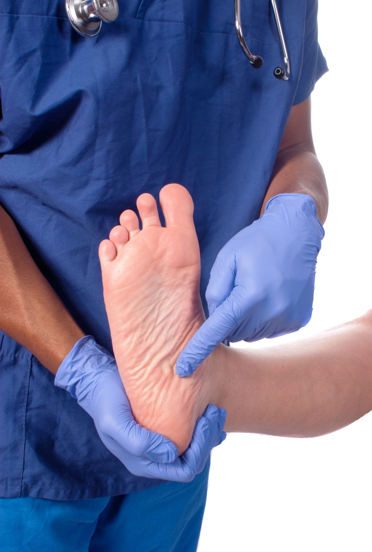 Surgeon pointing at foot