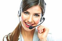 Stock photo of a call center employee wearing a headset.