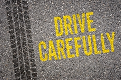 Drive Carefully Painted on the Ground