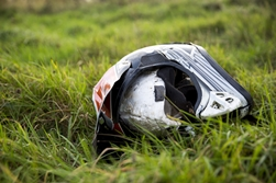 Helmet in the Grass After a Motorcycle Accident