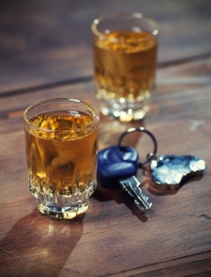 Two Shot Glasses With Alcohol and a Set of Keys