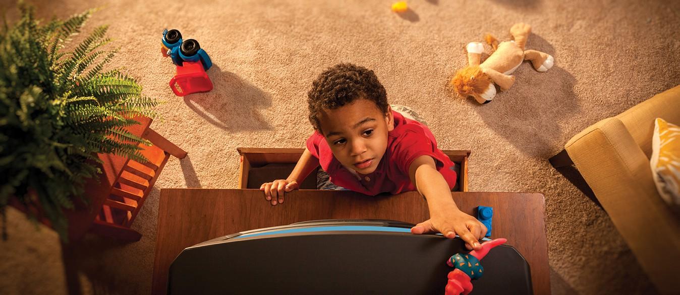 Boy climbing dresser