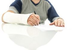 Injured Work in an Arm Cast Signing Paperwork