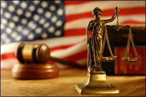 American flag, gavel, lady justice