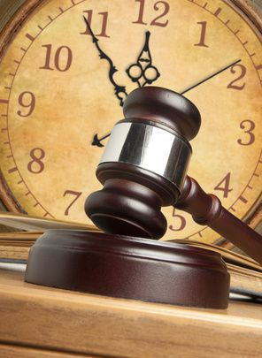 Gavel in front of a clock