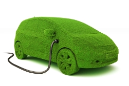 Green Electric Car That Is Plugged in