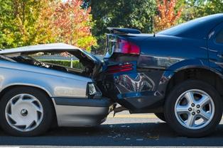Silver car rear-ending a blue sedan