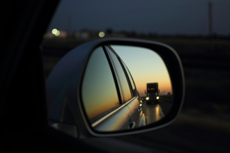 Semi truck in sideview mirror