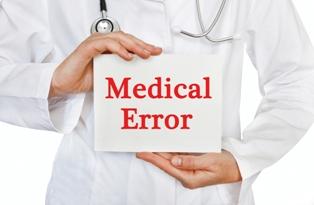 Doctor holding medical error sign