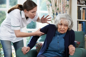 Nursing home patient being abused by caregiver
