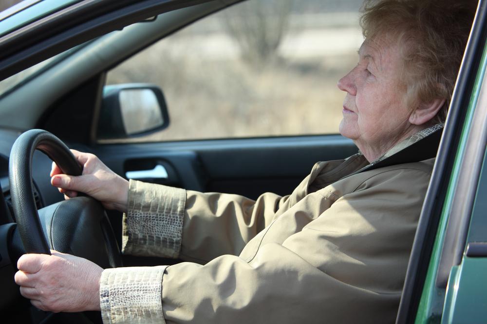Elderly woman driving a car