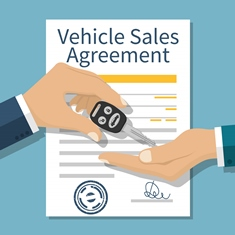 Salesperson Holding a Hand in Front of a Sales Agreement
