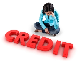 College Student Looking at a Red Credit Sign