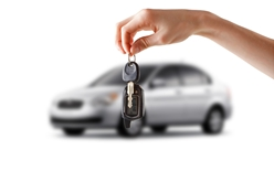 A Woman Holding a Set of Car Keys in Front of a New Car
