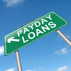 Green Payday Loans Sign With a Blue Sky Background