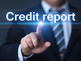 Businessman Pointing to a Credit Report Screen