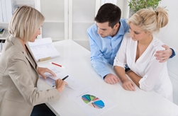 Credit Counselor Working With a Young Couple