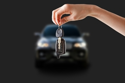 Financer Holding Keys in Front of a New Car