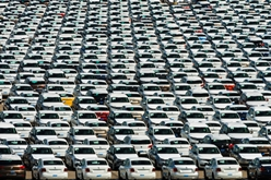Hundreds of Volkswagen Vehicles in a Parking Lot