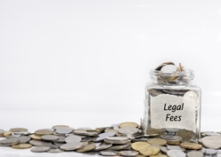 Legal Fees Jar Overflowing With Change