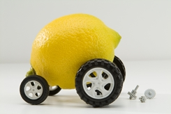 A Lemon Car With Broken Car Parts