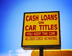 Yellow Car Title Loan Sign