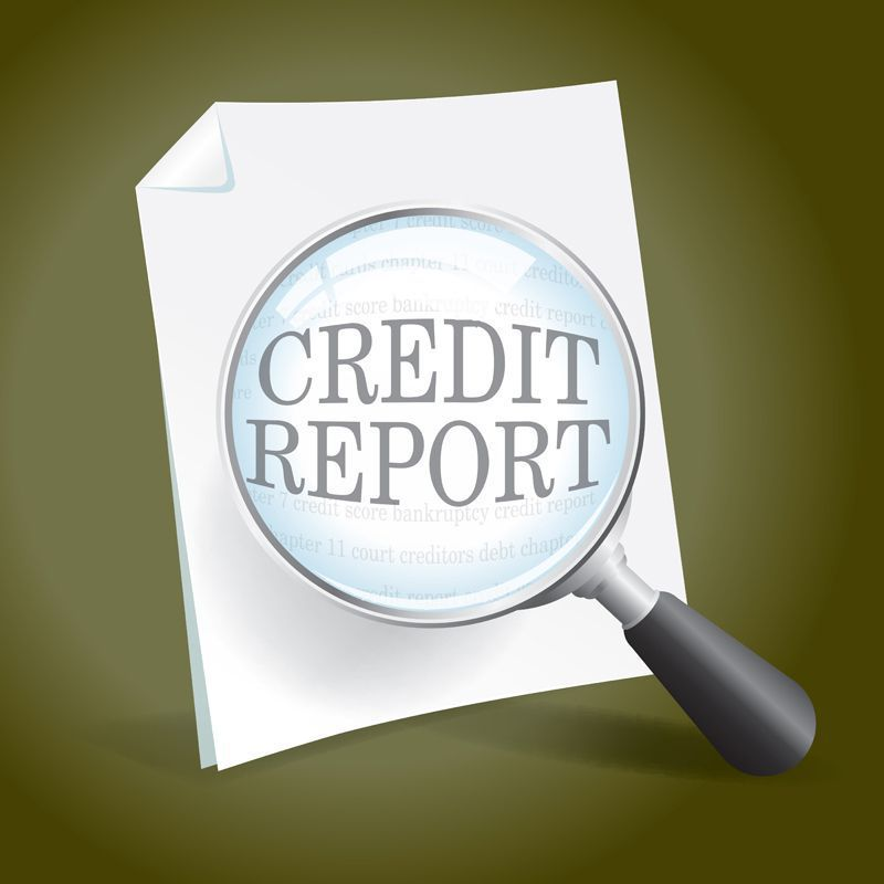 Magnifying Glass Looking at a Credit Report