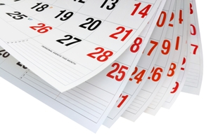 Flipping calendar pages showing the passage of time