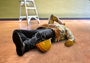 Worker on floor after a fall from a ladder