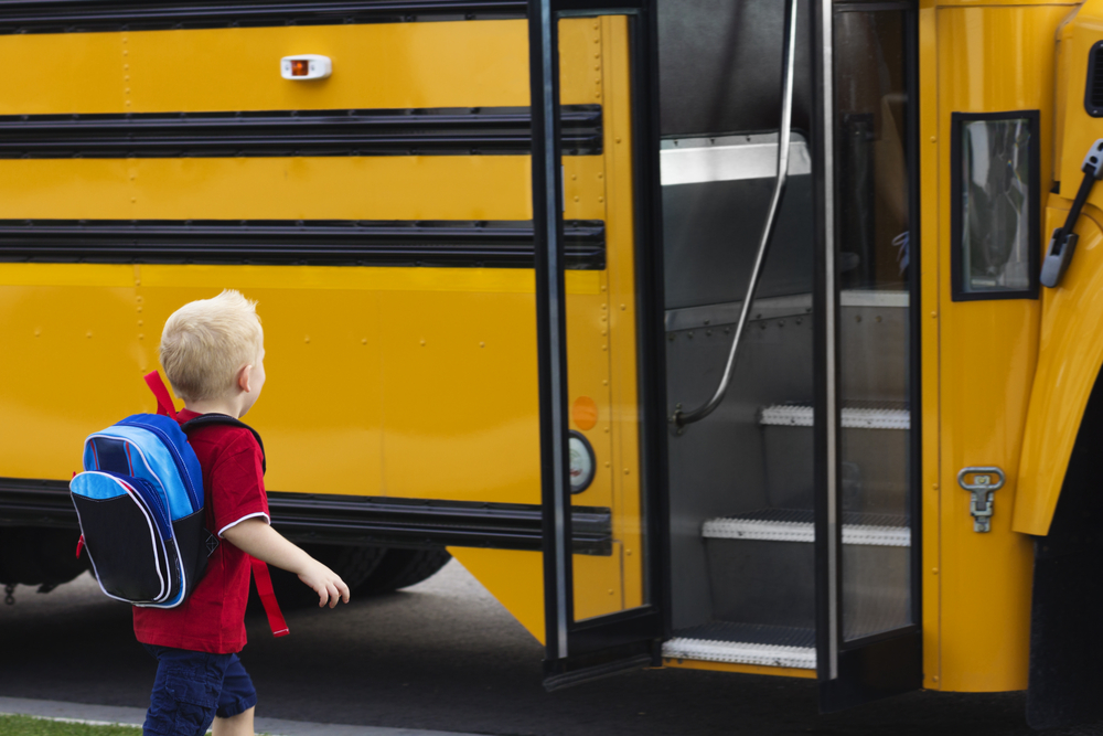 Child boarding school bus