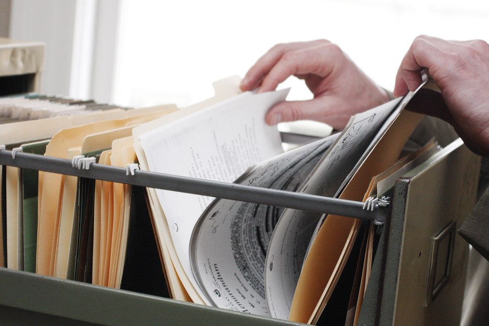 Person going through filing cabinet